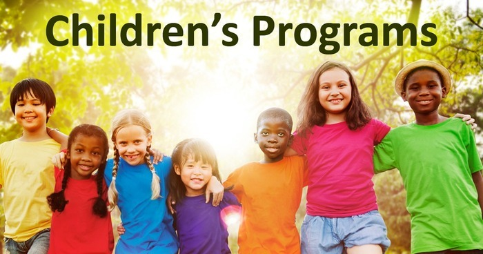 A group of children in bright shirts stand arm in arm. Text reads Children's Programs.